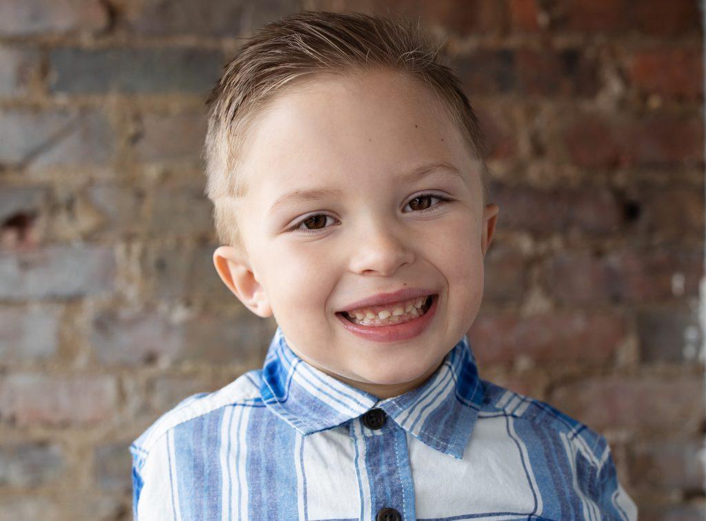 little boy in plaid shirt